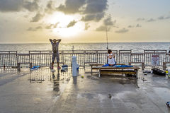 People at fishing Pier in Sunny Royalty Free Stock Image