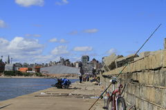 People fishing at the Port of Montevideo Uruguay Stock Photography