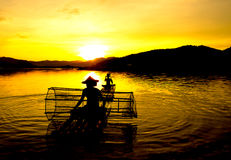 People fishing in river On the bright sky a beautiful golden royalty free stock image