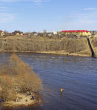People are fishing on river Narva Stock Photography