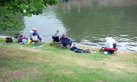 People fishing on the riverside Royalty Free Stock Images
