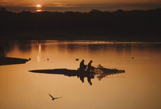 People fishing at sunrise Royalty Free Stock Images