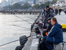People fishing on the waterfront of Yalta, Crimea Stock Photos