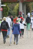 WROCLAW, POLAND - OCTOBER 15, 2017: People in fitness course nordic walking competition in the city park Royalty Free Stock Photo