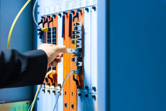 People fix core switch in network room.  Royalty Free Stock Photos