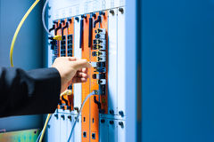 People fix core switch in network room Stock Photography