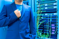 People fix core switch in network room Stock Photo