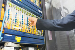 People fix core switch in network room Royalty Free Stock Photos