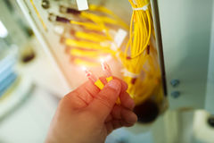 People fix core switch in network room Royalty Free Stock Photography