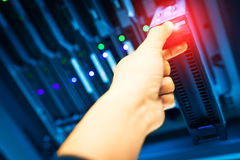 People fix core switch in network room Royalty Free Stock Images