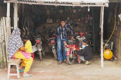 People fix motorbike in a workshop in Puthia, Bangladesh. Stock Photos