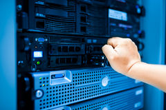 People fix server network in data room.  Royalty Free Stock Photo