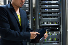 People fix server network in data room.  Stock Photo