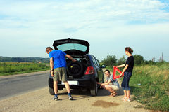 People fixing a flat tire Royalty Free Stock Image