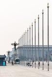 People, flagpoles on Tiananmen Square Stock Photo