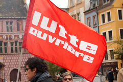 People with flags during the demonstration against misery and poverty - workers struggle (text in french) Stock Photo