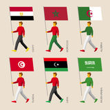 People with flags: Egypt, Libya, Saudi Arabia, Tunisia, Morocco, Algeria. Set of simple flat people with flags of Middle East countries. Standard bearers Royalty Free Stock Photography