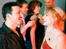 People flirting and drinking in a bar Stock Images
