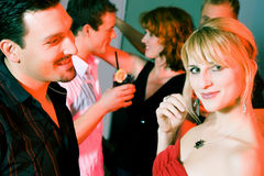 People flirting and drinking in a bar royalty free stock image