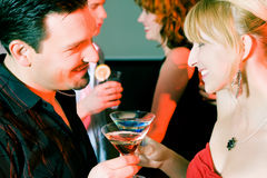 People flirting and drinking in a bar Stock Photos