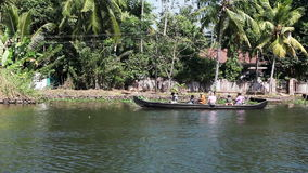 People float by the boat in Kerala backwaters on February 8, 2014 in Kerala, India stock video footage