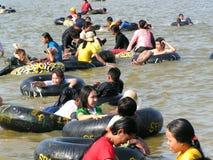 People floating on swim rings Royalty Free Stock Photo