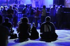 People on the floor watch a concert at FIB (Festival Internacional de Benicassim) 2013 Festival Royalty Free Stock Photo