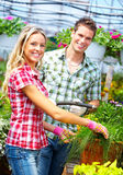 People florists. Young smiling people florists working in the garden Royalty Free Stock Image