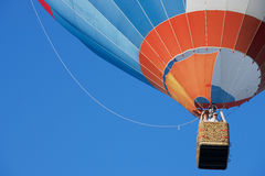 People fly in hot air balloon over the old town in Vilnius, Lithuania. Royalty Free Stock Images