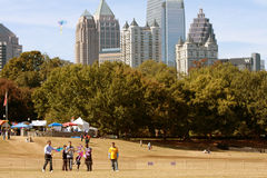 People Fly Kites In Park Against Atlanta City Skyline Stock Images