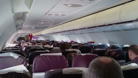 People flying on board of economy class passenger plane. Aircraft in turbulence. Stock footage stock video