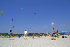 People flying kites on the beach Royalty Free Stock Photography