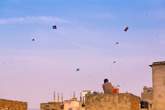 People flying kites from their rooftops in old delhi jaipur city Royalty Free Stock Image