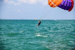 People flying on parachute ride in air flight ,background blue sky travel summer vacation tourism royalty free stock photo