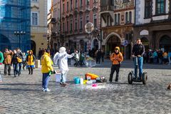 People flying soap bubbles forming Old Town Square Prague, Czech Republic Royalty Free Stock Image