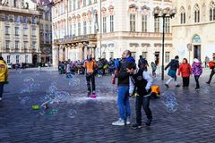 People flying soap bubbles forming Old Town Square Prague, Czech Republic Royalty Free Stock Photos