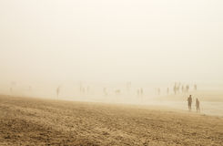 People in fog beach Stock Photos