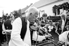 People in folk costume and musician Royalty Free Stock Images
