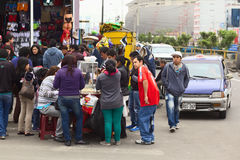 People at Foodstand in Downtown Lima, Peru Stock Image