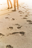 People foot prints on the beach sand Stock Photography