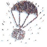 People in the form of a parachute. Large group of people in the form of a parachute. White background, isolated Royalty Free Stock Image