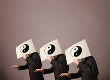 People in formal gesturing with yin yang sign Stock Photo