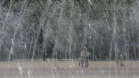 People at the fountain. Images is blurred, no recognizable people stock video footage