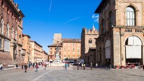 People and Fountain on Piazza del Nettuno. BOLOGNA, ITALY - OCTOBER 31, 2012: people and Fountain on Piazza del Nettuno in Bologna city.The Nettuno fountain was royalty free stock photography