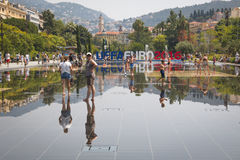 People in the fountains on the main square in Nice, France Royalty Free Stock Images