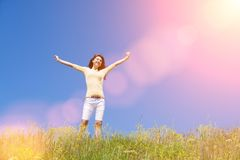 Free People Freedom Success Concept. Happy Woman Dreams To Fly On Winds. Landscape Of Grass And Flower Summer Field On Sunny Day. Stock Photography - 148341912