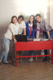 People friends working at home at the table Stock Photos