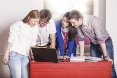 People friends working at home at the table Stock Images