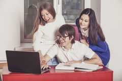 People friends working at home at the table Royalty Free Stock Image
