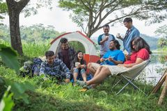 Friendship Hangout Traveling Destination. People Friendship Hangout Traveling Destination Camping Concept near lake Royalty Free Stock Photography